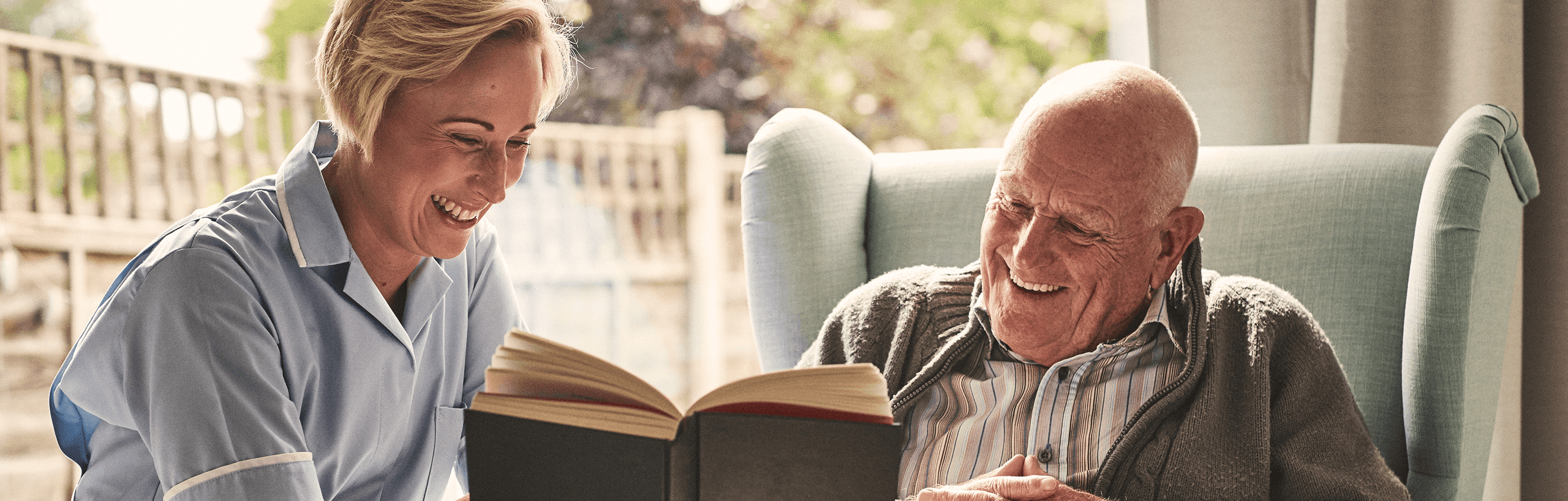 Caregiver reading a book to a loved one in Florida
